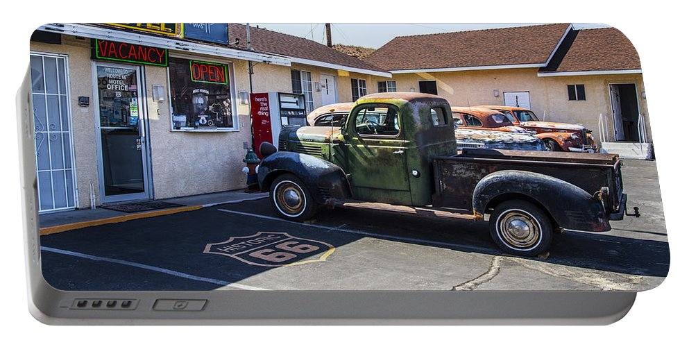 Route 66 Portable Battery Charger featuring the photograph Studebaker by Angus Hooper Iii