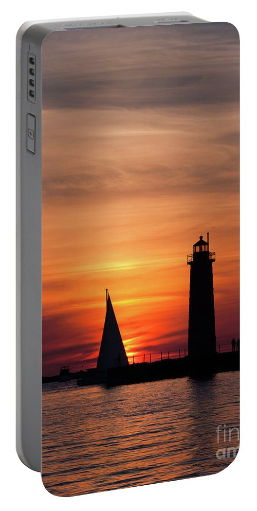 Sailboat Portable Battery Charger featuring the photograph Sun Set At The Muskegon Lighthouse by John Harmon
