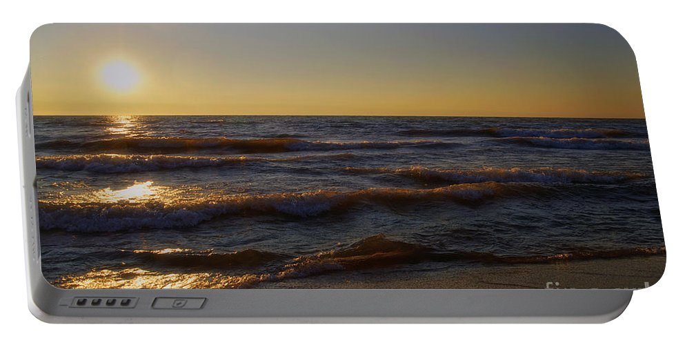 Lake Michigan Portable Battery Charger featuring the photograph Sundown Scintillate On The Waves by Thomas Woolworth