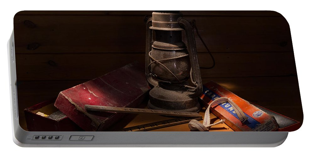 Hurricane Lamp Portable Battery Charger featuring the photograph Sunlight In The Workshop by Ann Garrett