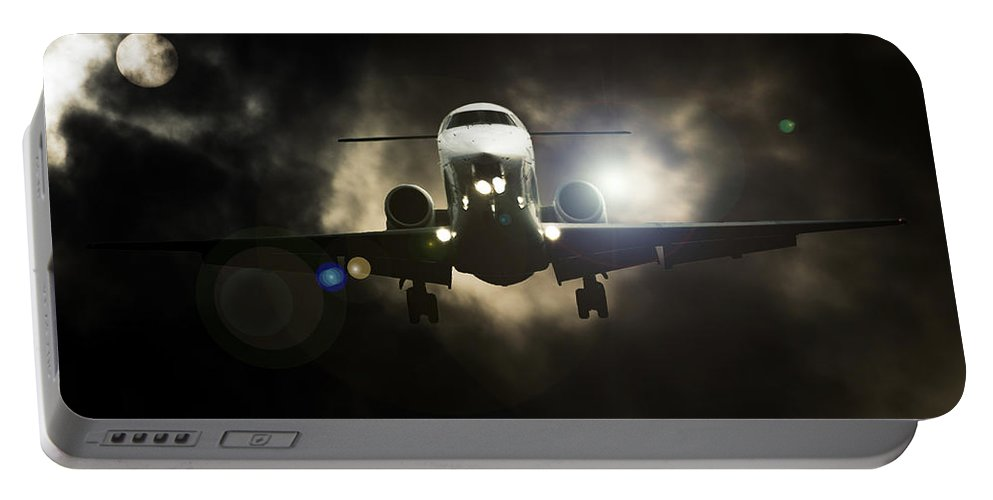 Learjet Portable Battery Charger featuring the photograph Sunlight Landing by Paul Job