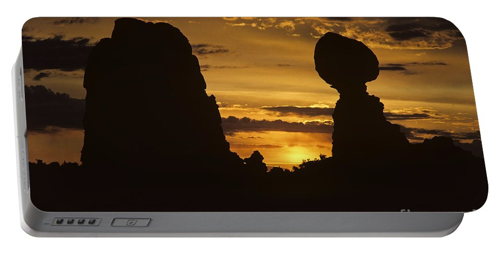 Landscape Portable Battery Charger featuring the photograph Sunrise Arches National Park With Balanced Rock Silhouetted Agai by Jim Corwin