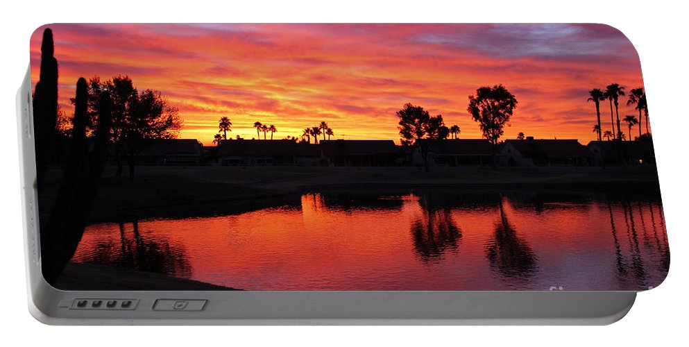 Sunsets/sunrises Portable Battery Charger featuring the photograph Sunrise At Polly's by Bob Hislop