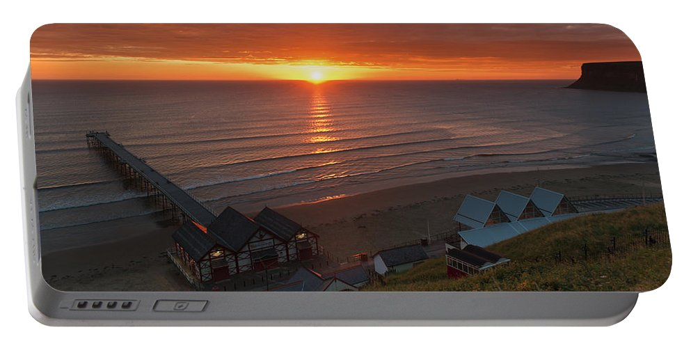 Sunrise Portable Battery Charger featuring the photograph Sunrise At Saltburn by Gary Eason