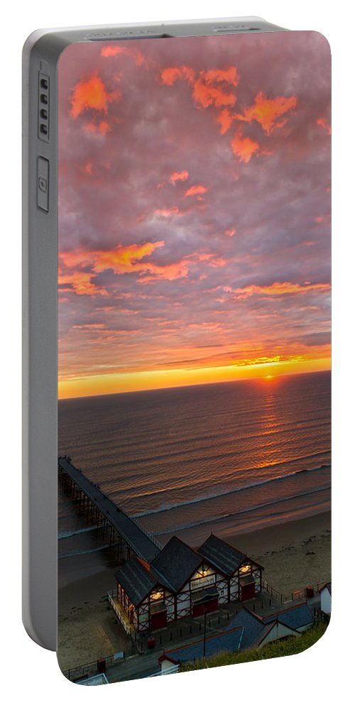 Sunrise Portable Battery Charger featuring the photograph Sunrise At Saltburn Pier And Seafront Portrait by Gary Eason