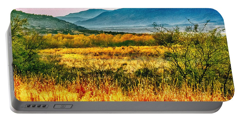 Sunrise Portable Battery Charger featuring the photograph Sunrise In Verde Valley Arizona by Bob and Nadine Johnston