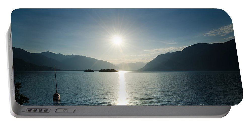 Sunrise Portable Battery Charger featuring the photograph Sunrise Reflected Over An Alpine Lake by Mats Silvan