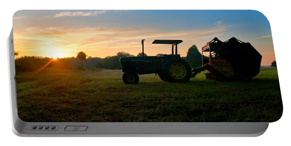 Sunrise Portable Battery Charger featuring the photograph Sunrise Tractor by Scott Hansen