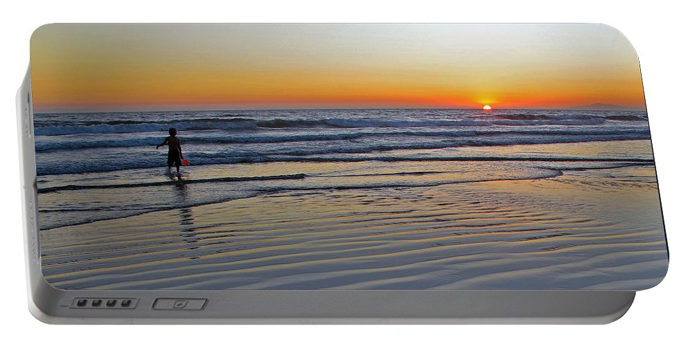 Ocean Portable Battery Charger featuring the photograph Sunset At The Beach by Kelly Holm