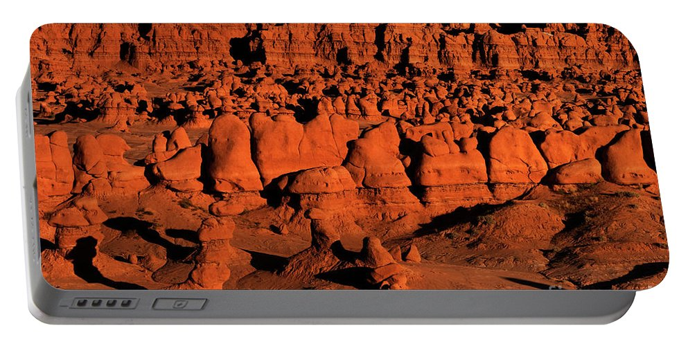 North America Portable Battery Charger featuring the photograph Sunset Light Turns The Hoodoos Blood Red In Goblin Valley State Park Utah by Dave Welling