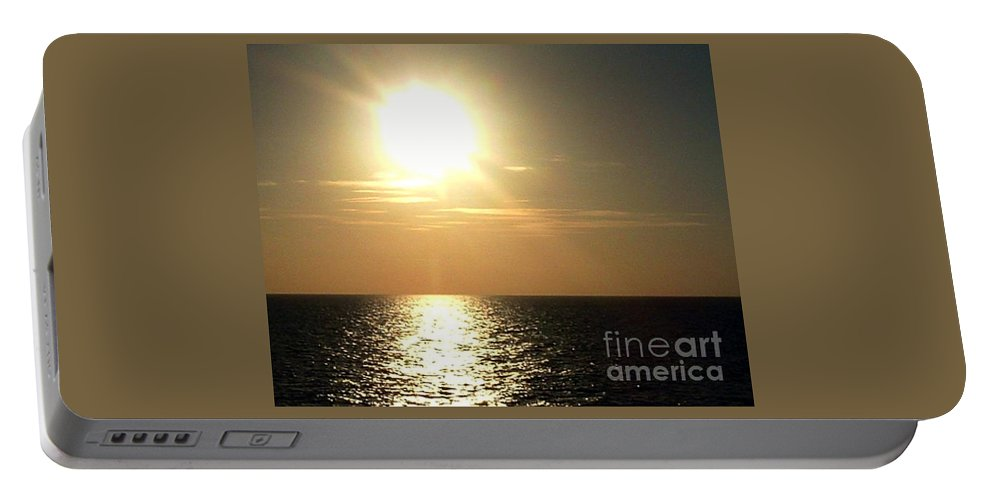 Photograph Portable Battery Charger featuring the photograph Sunset Over The Ocean by Anita Lewis
