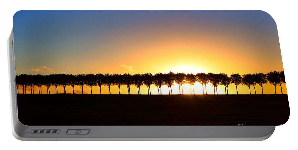 France Portable Battery Charger featuring the photograph Sunset Over Tree Lined Road by Olivier Le Queinec