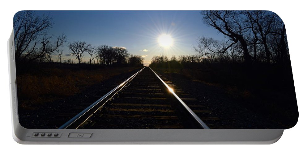 Sunset Portable Battery Charger featuring the photograph Sunset Tracks by Mark Hudon