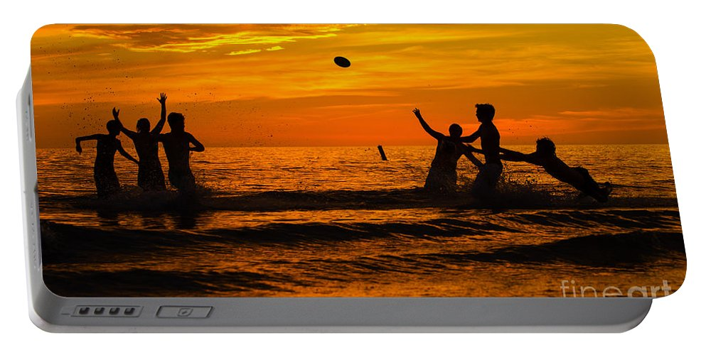 Sunset Portable Battery Charger featuring the photograph Sunset Water Football by Anne Kitzman