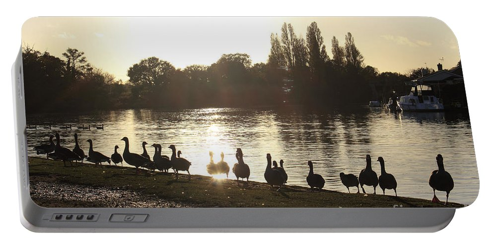 Sunset With Geese Thames Uk London England Britain British English Landscape Countryside River Surrey Silhouette Goose Duck Ducks Water Sparkle Trees Reflected Warm Glow United Kingdon Riverbank Portable Battery Charger featuring the photograph Sunset With Geese On The Thames by Julia Gavin