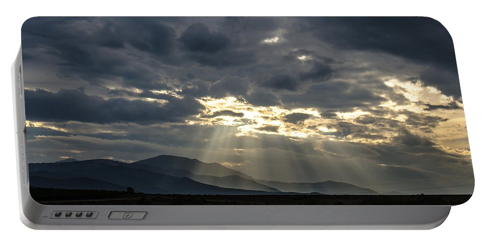 Spring Portable Battery Charger featuring the photograph Sunshines by Sotiris Filippou