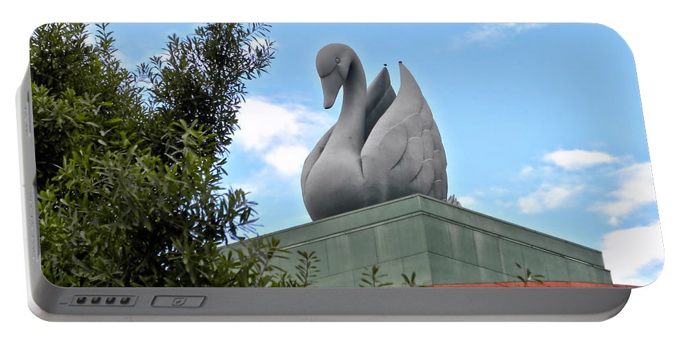 Swan Resort Portable Battery Charger featuring the photograph Swan Resort Statue Walt Disney World by Thomas Woolworth