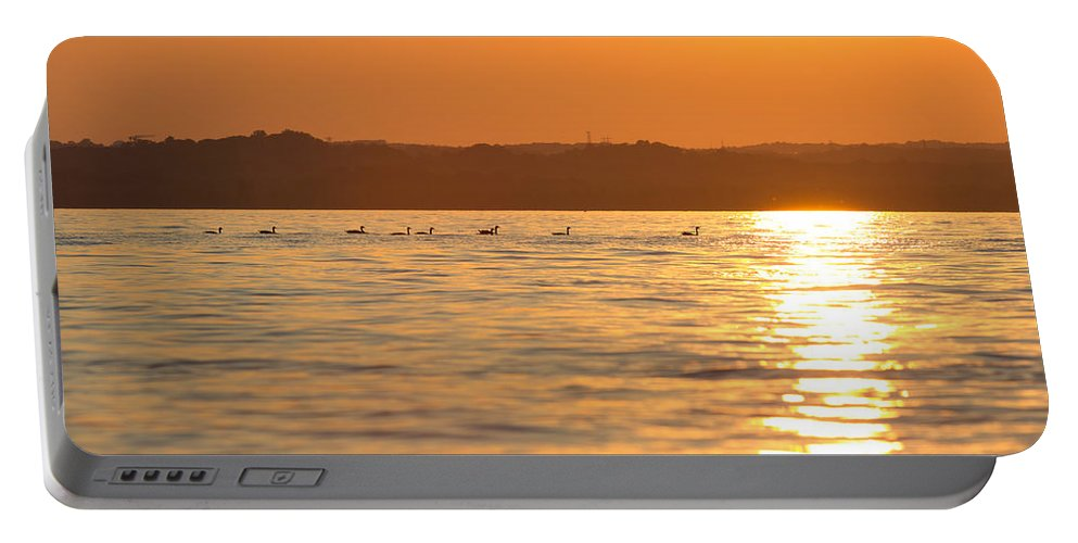 Indian Head Portable Battery Charger featuring the photograph Swimming Into The Sun by Leah Palmer