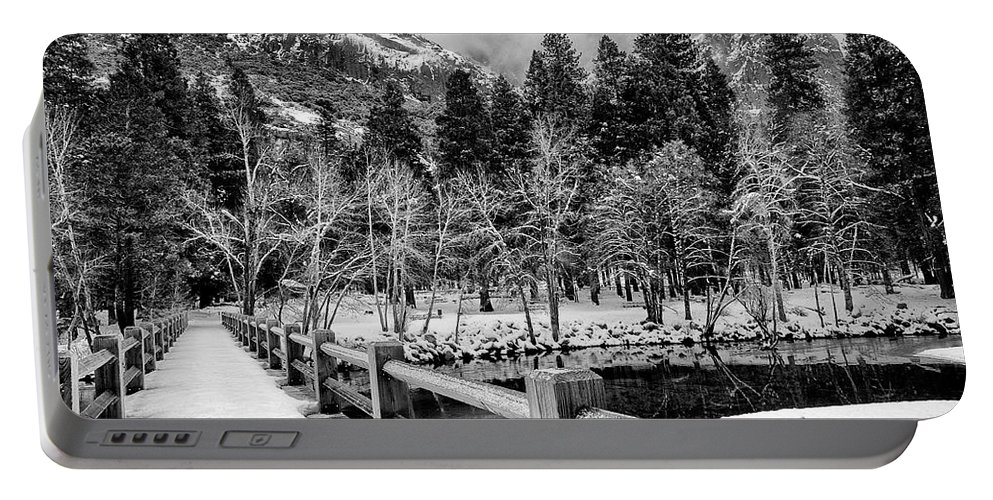 Water Portable Battery Charger featuring the photograph Swinging Bridge In Winter by Cat Connor