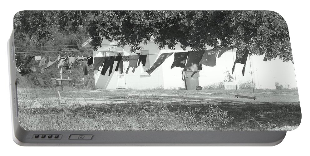 Black And White Laundry Portable Battery Charger featuring the photograph Swinging Laundry by Michelle Powell