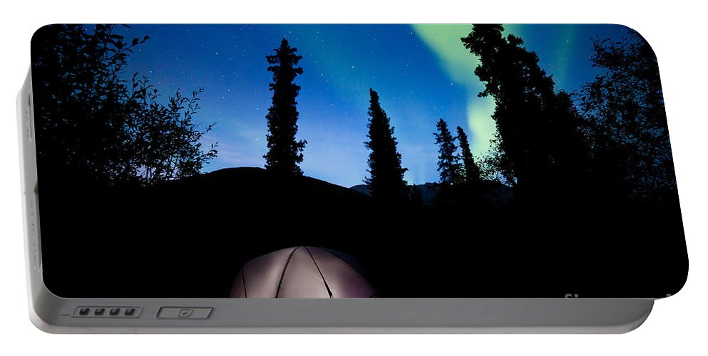 Adventure Portable Battery Charger featuring the photograph Taiga Tent Illuminated Under Northern Lights Flare by Stephan Pietzko