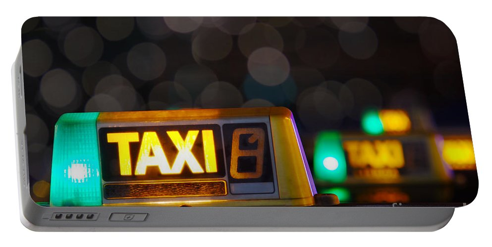 Auto Portable Battery Charger featuring the photograph Taxi Signs by Carlos Caetano