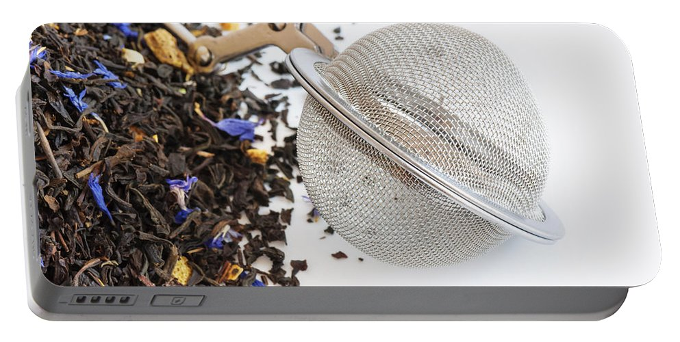 Theine Portable Battery Charger featuring the photograph Tea Ball Infuser And Scented Tea by Dutourdumonde Photography