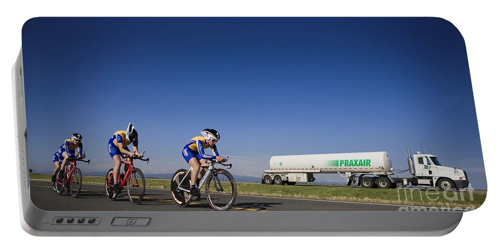 Cycling Portable Battery Charger featuring the photograph Team Time Trial Chasing A Tanker Truck by Jason O Watson
