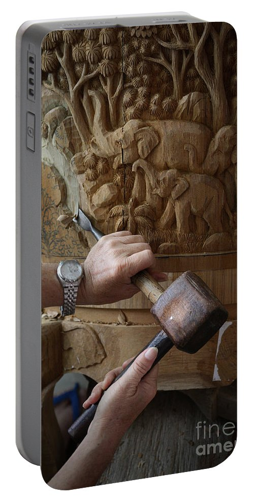 Asia Portable Battery Charger featuring the photograph Thai Woodworker by Inge Johnsson