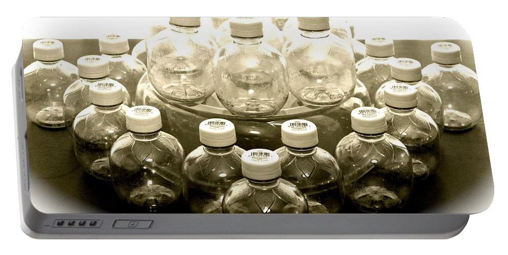 Still Life Portable Battery Charger featuring the photograph The Apple Bottle by Lorna Maza