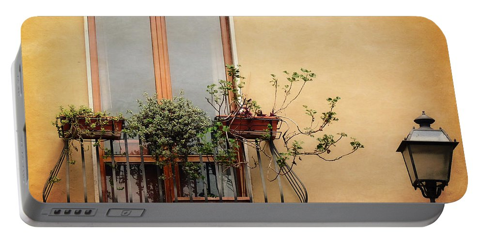 Windows Portable Battery Charger featuring the photograph The Balcony by Lucinda Walter