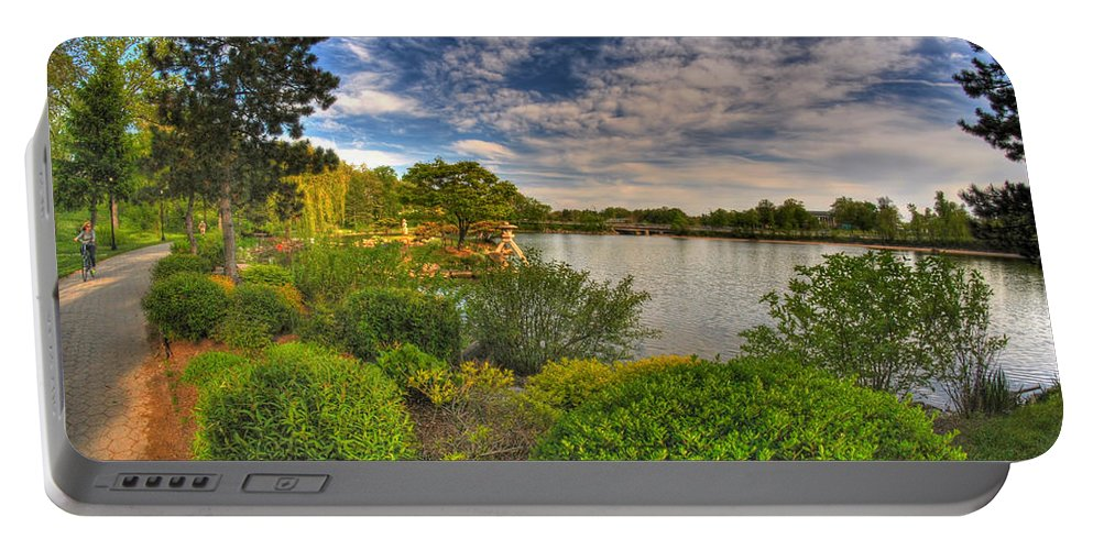 Garden Portable Battery Charger featuring the photograph The Bike Ride by Michael Frank Jr