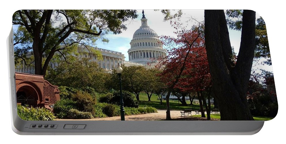 The Capitol Portable Battery Charger featuring the photograph The Capitol Building by Lois Ivancin Tavaf