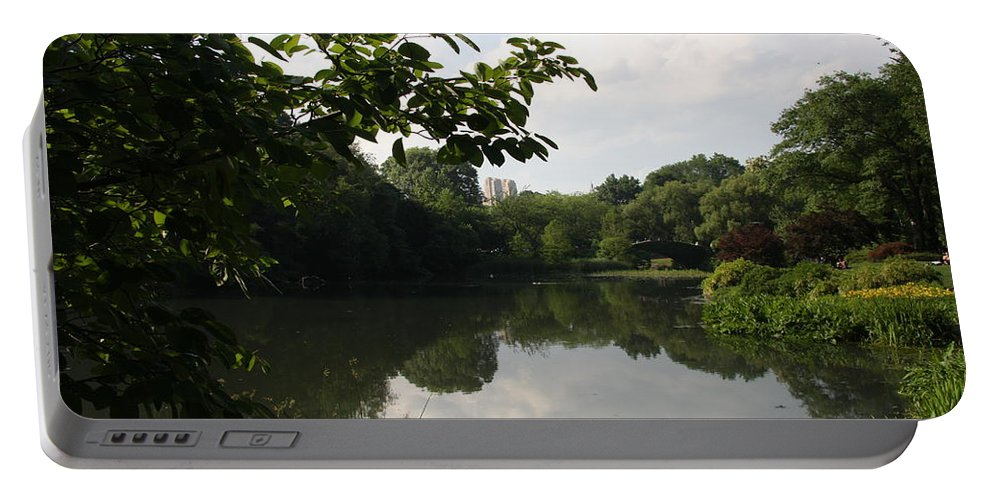 Pond Portable Battery Charger featuring the photograph The Central Park Pond by Christiane Schulze Art And Photography