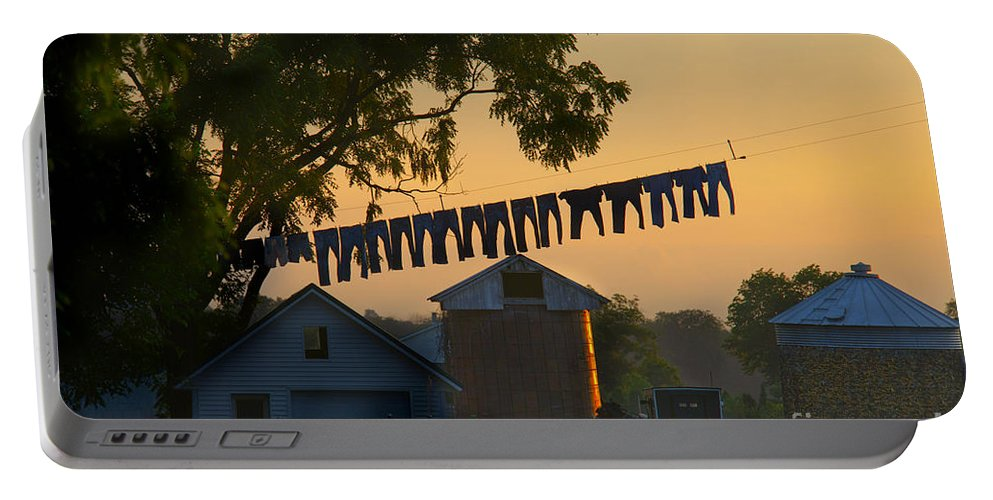 Amish Portable Battery Charger featuring the photograph The Clothes Line by David Arment