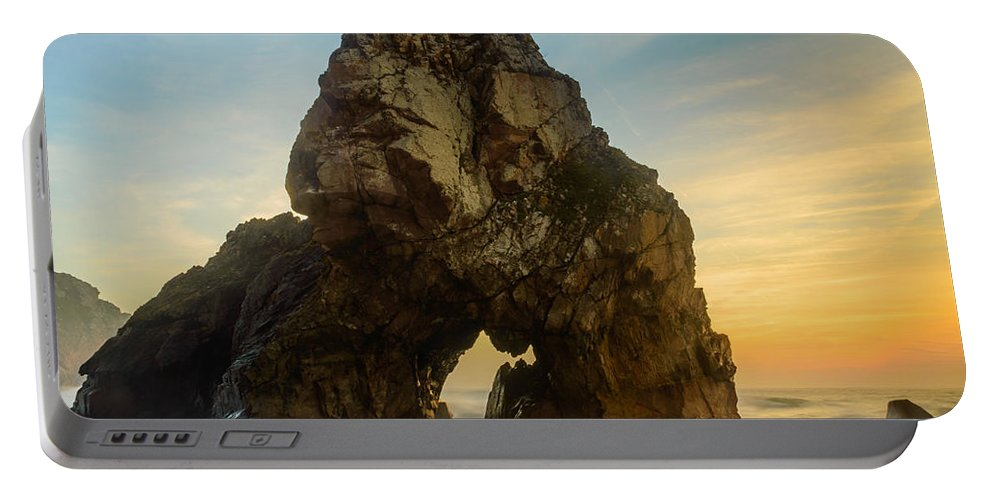Rock Portable Battery Charger featuring the photograph The Giant Of The Seas I by Marco Oliveira