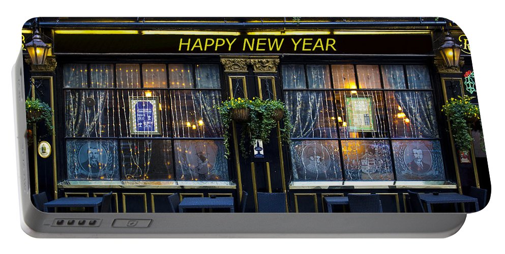 Pub Portable Battery Charger featuring the photograph The Happy New Year Pub by David Pyatt