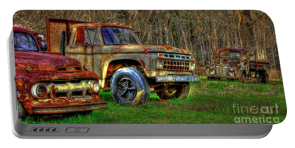 Reid Callaway Stormy Day Portable Battery Charger featuring the photograph The Hard Headed Ford Work Horses. by Reid Callaway