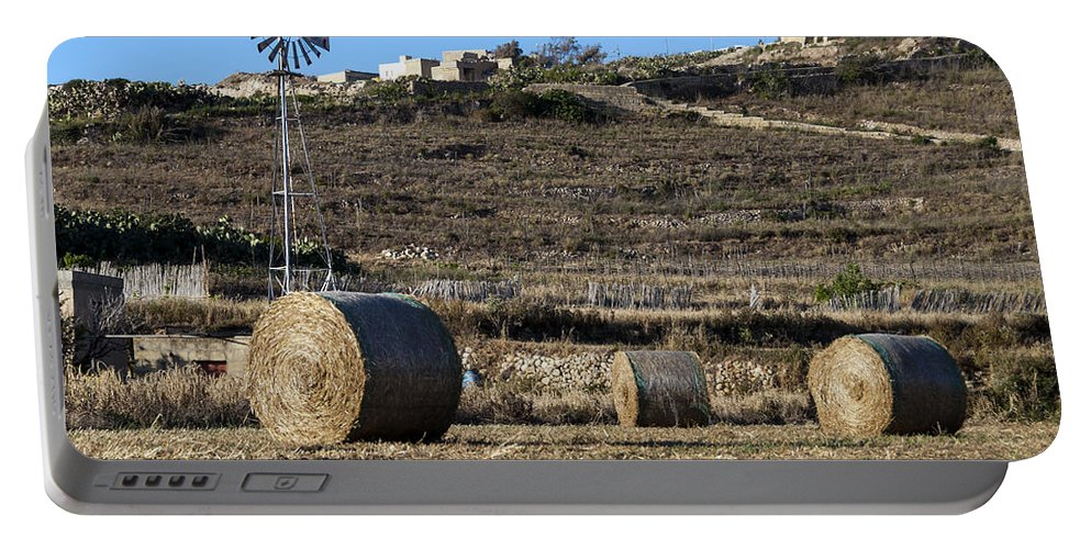 Sulla Portable Battery Charger featuring the photograph The Harvest by Focus Fotos