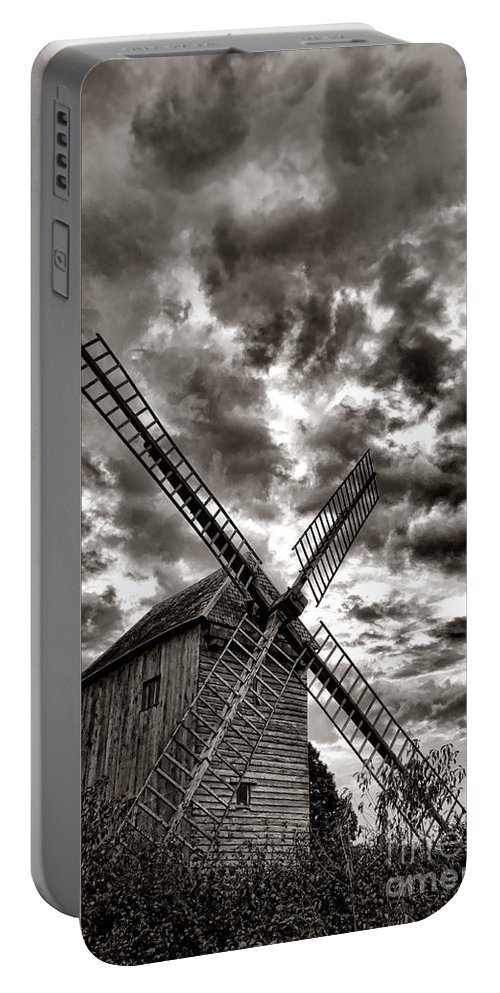 Windmill Portable Battery Charger featuring the photograph The Last Windmill by Olivier Le Queinec
