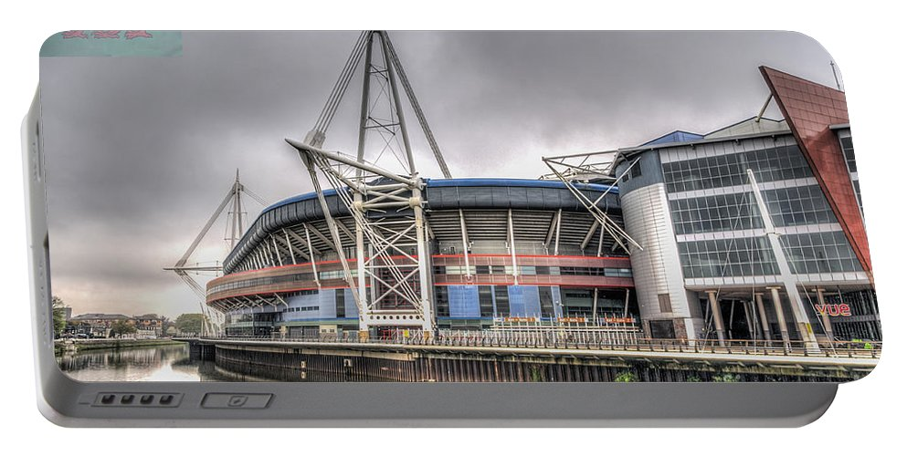 The Millennium Stadium Portable Battery Charger featuring the photograph The Millennium Stadium With Flag by Steve Purnell