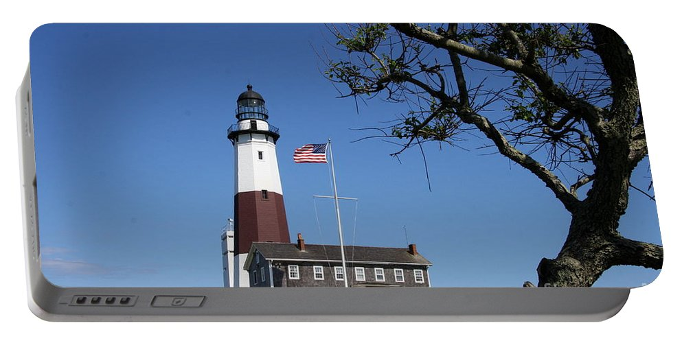 Montauk Point Lighthouse Portable Battery Charger featuring the photograph The Montauk Point Lighthouse by Christiane Schulze Art And Photography