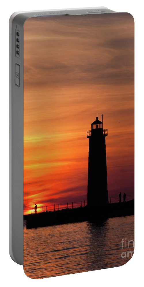 Nautical Portable Battery Charger featuring the photograph The Muskegon Lighthouse An A Lone Man Fishing by John Harmon