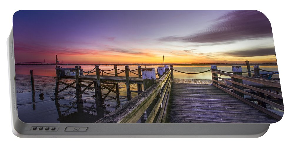 Boats Portable Battery Charger featuring the photograph The Old Pier by Debra and Dave Vanderlaan