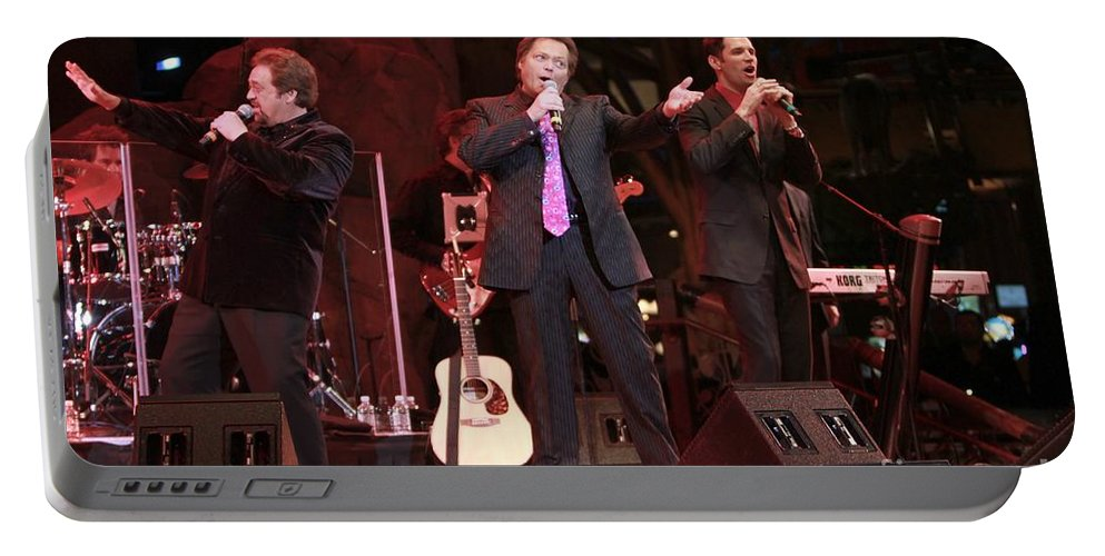 The Osmond Brothers Portable Battery Charger featuring the photograph The Osmond Brothers by Concert Photos