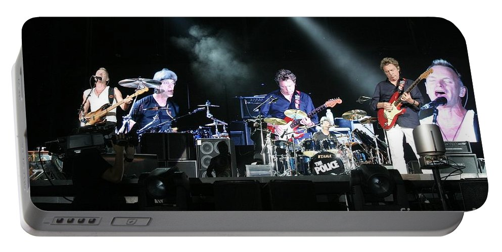 Performance Portable Battery Charger featuring the photograph The Police by Concert Photos