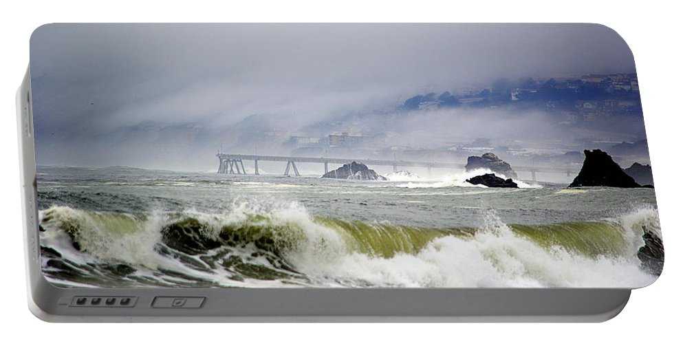 Scenic Portable Battery Charger featuring the photograph The Restless Sea by AJ Schibig
