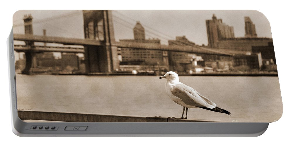 Newyork08 Portable Battery Charger featuring the photograph The Seagull Of The Brooklyn Bridge Vintage Look by RicardMN Photography