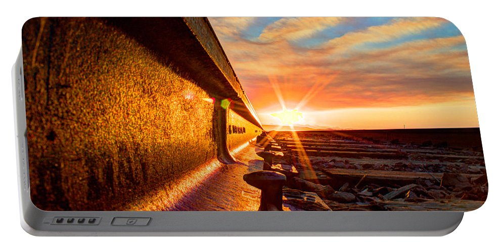 Railroad Tracks Portable Battery Charger featuring the photograph The Side Of The Rail by John Lee