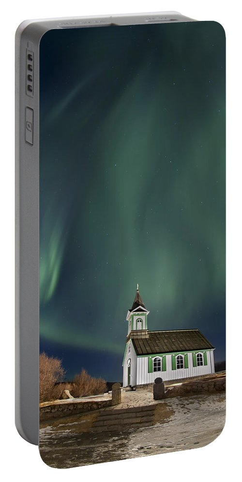 Aurora Portable Battery Charger featuring the photograph The Spirit Of Iceland by Evelina Kremsdorf